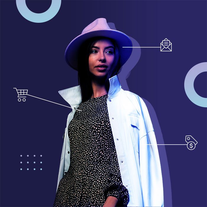 Model wearing outfit with shopping icons pointing to each garment